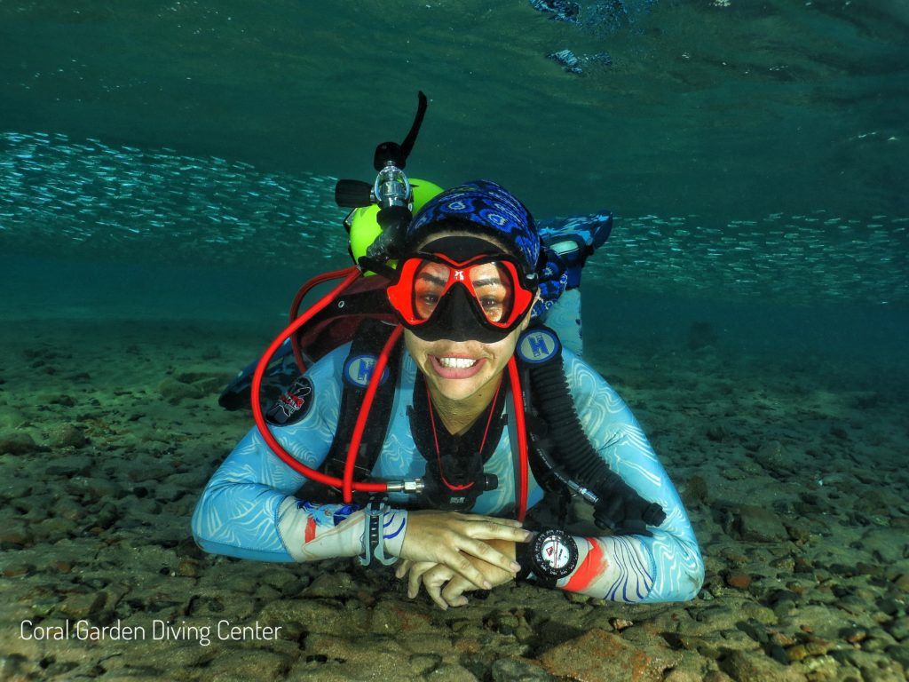 Girl diver smiling underwater Red Sea