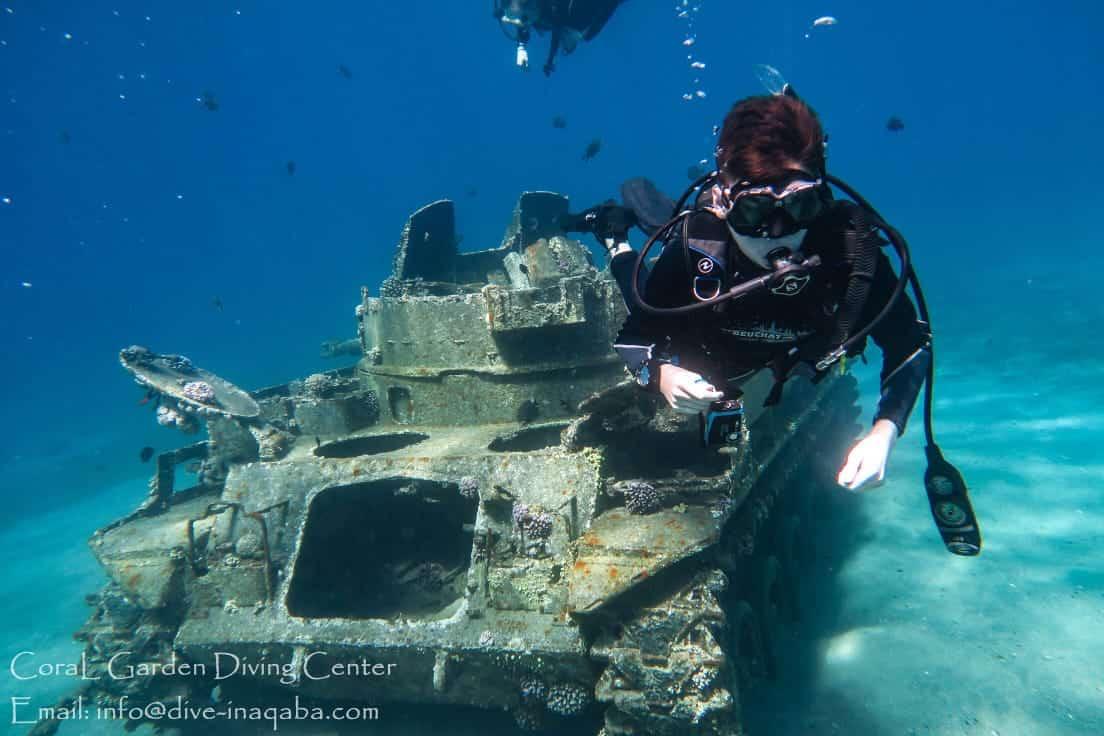 kids dive next the tank