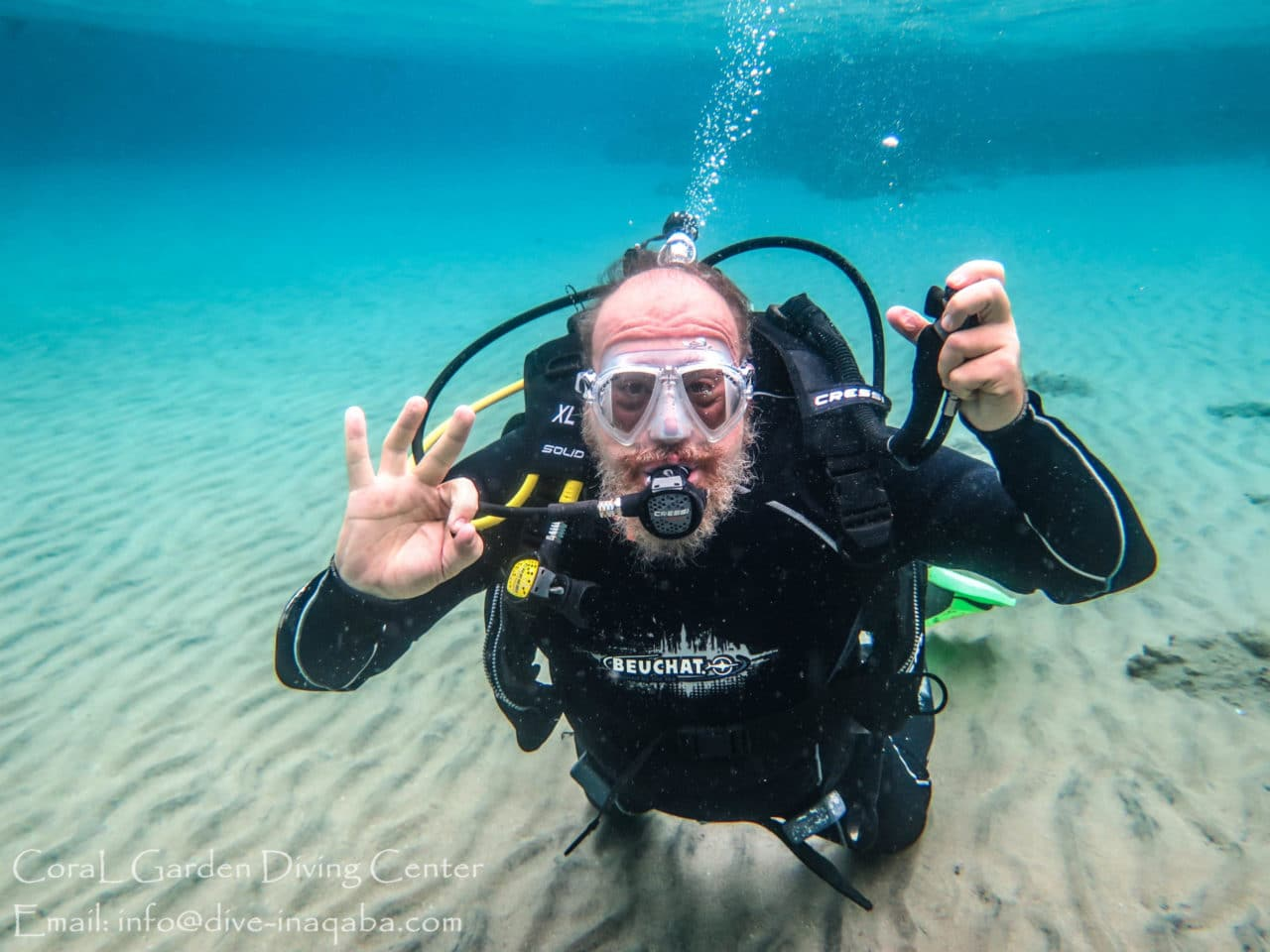 Man dive in shallow water